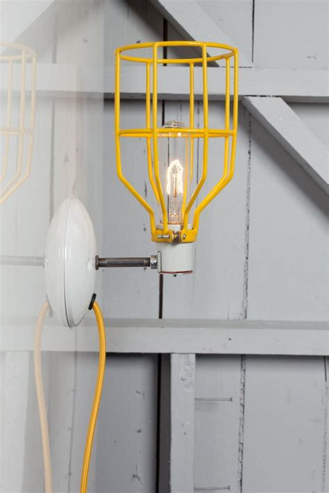 industrial wall light yellow industrial wall light yellow wire cage l plug in