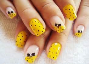Cute nail designs with yellow : Black dots bows yellow nails favnails