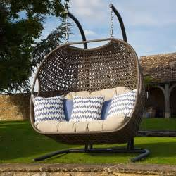 hanging cocoon chair including fawn cushions