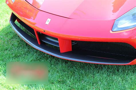 """This is a set with the middle part which has threaded inserts for mounting. Best Exhaust - Sforza Ferrari 488 Carbon Front Spoiler - Pastel """"Red Scuderia"""" SF/C/86975110/488"""