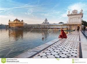 Woman In A Red Saree Sits And Pray In Golden Temple In The ...