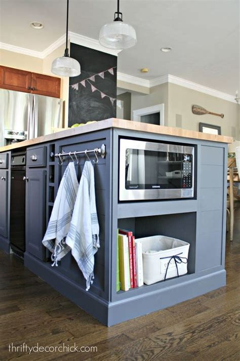 how to hang a microwave under a cabinet microwave in the island finally towels bar and islands