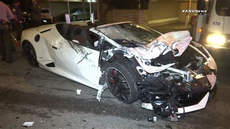 crashed white lamborghini 2 men sought after lamborghini crashes into parked car in