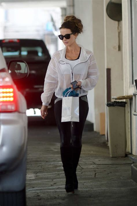 kate beckinsale wears a white see-through windbreaker over ...
