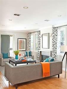 Modern Gray living room with turquoise and orange accents