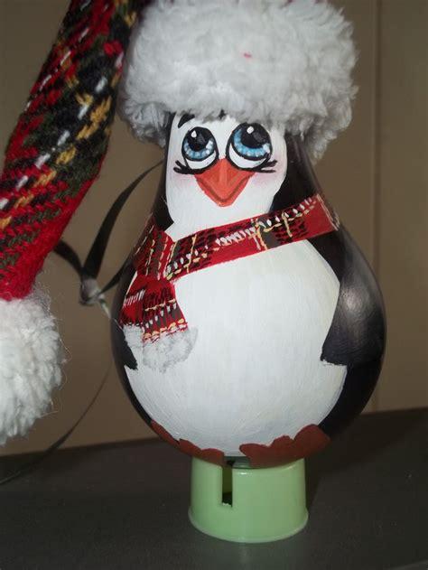 penguin hand painted by amanda kirk light bulb ornament light bulb ideas pinterest