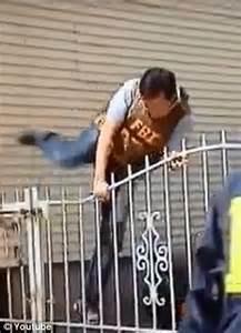 Outrageous Moment FBI Agent Climbs Over Gate Just