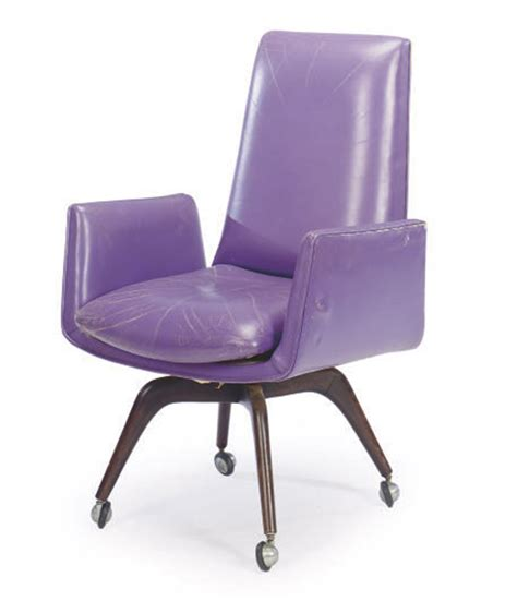 a purple leather upholstered desk chair by vladimir