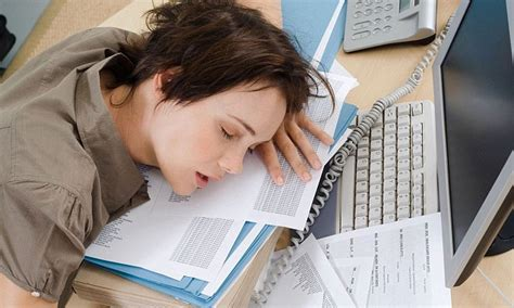 1 in 5 workers admits falling asleep at their desk with ...