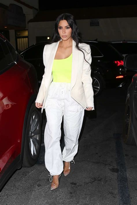 Kim Kardashian spotted wearing a yellow top with cream ...