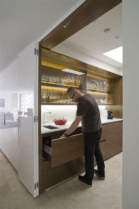small space solutions hidden kitchen  minosa design