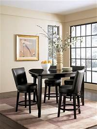 triangular dining table Emory Triangular Counter Height Dining Table by Ashley ...