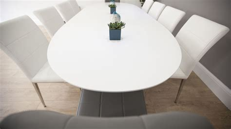 white oval extending dining table quilted faux leather