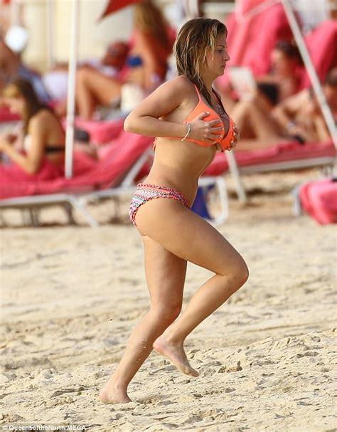Busty Zara Holland soaks up the sunshine in Barbados ...