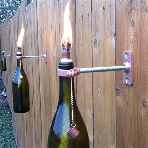mounted wine bottle tiki torches the green