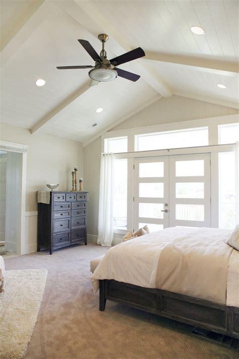 master bedroom high ceiling bright windows   fan