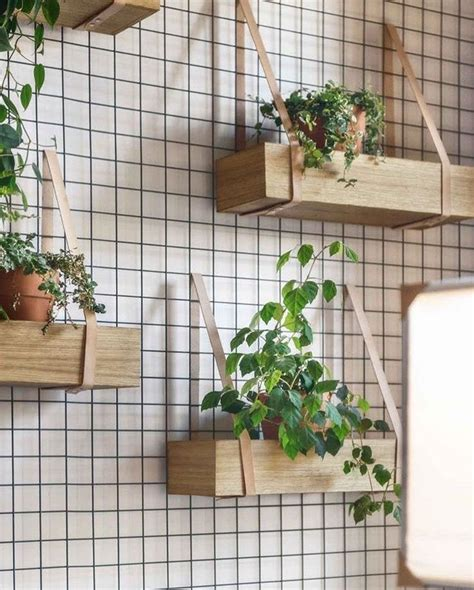 wooden planter boxes suspended  leather  metal
