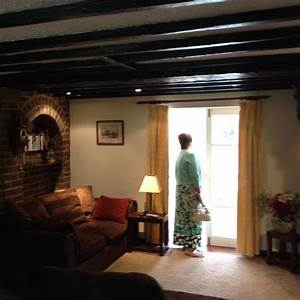 How to lighten a cottage with small windows and black