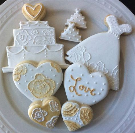 decorated white and gold wedding dress and cake cookies