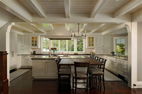 Kitchen built in table kitchen traditional with white cabinets breakfast bar dual farmhouse sinks