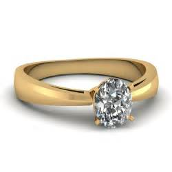 solitaire yellow gold engagement rings oval shaped engagement rings with white diamonds in 18k yellow gold narrow edged ring