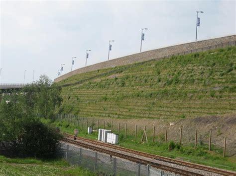 retaining wall on steep slope steep slopes tensar uk