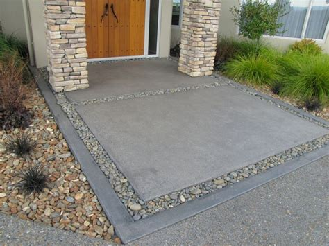 patio driveway ideas exposed aggregate driveway with charcoal coloured concrete inset tustin flip pinterest
