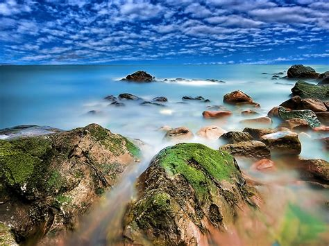 Seaside Coastline Red Rocks With Green Moss Turquoise ...