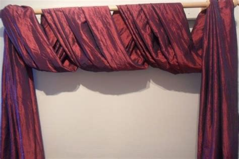 ways to drape a scarf the second great way to hang your scarf swag curtains