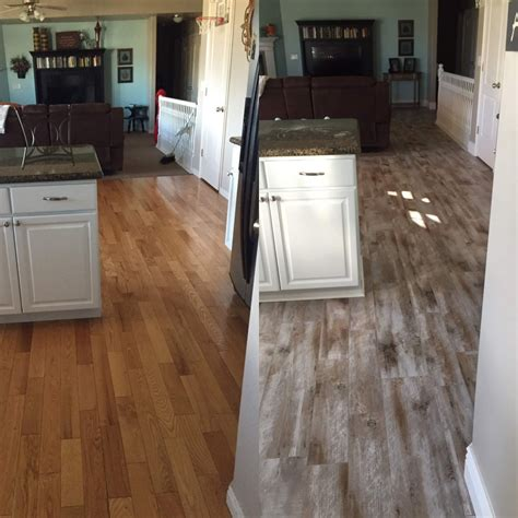 wood or tile in kitchen flooring before and after reveal wood looking tile 365 1945