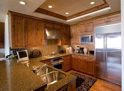 The first option is to keep the soffit open; Replacing Fluorescent Lights in the Kitchen   Kitchen lighting remodel, Kitchen ceiling lights ...