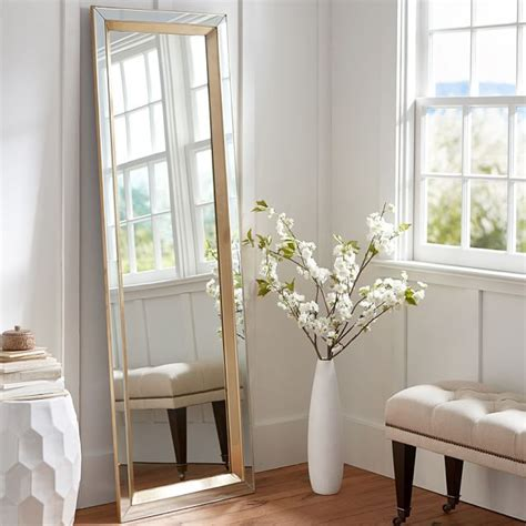 floor mirror rooms to go tilting a large floor mirror against the wall not only adds the illusion of more space to a room