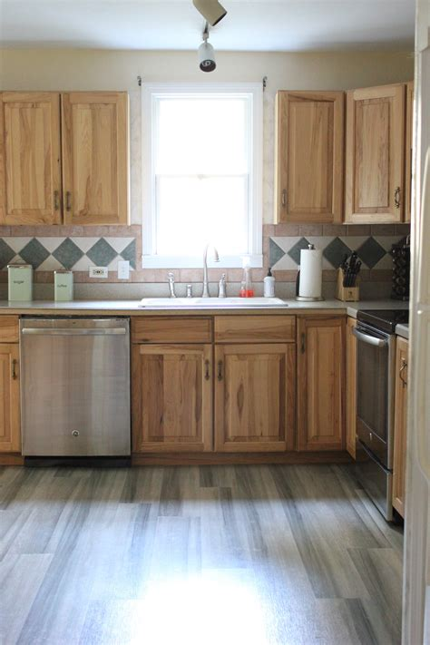 oak cabinets in kitchen kitchen progress pergo flooring before and after 3562