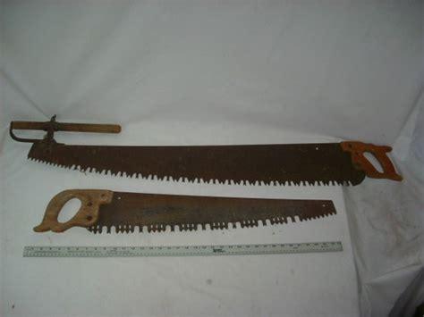 vintage   man disston cross cut  antique tool primitive rare saws vintage antiques