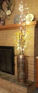 repurposed antique extinguisher with bamboo sticks
