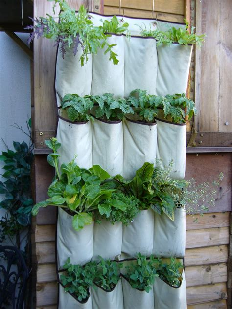 diy hanging planters for fences from recycled white fabric