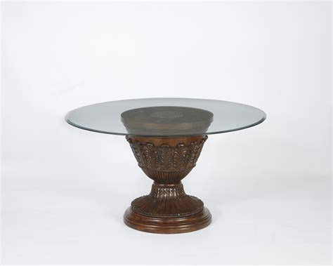 Small Round Glass Dining Table With Hand Carved Brown