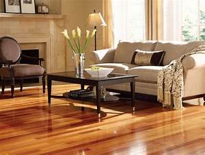 25 stunning living rooms with hardwood floors for Wood floors in living room