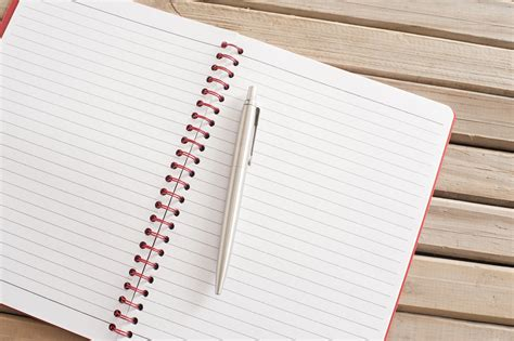 Image Of Open Blank Notebook With Ballpoint Pen On Top Freebiephotography