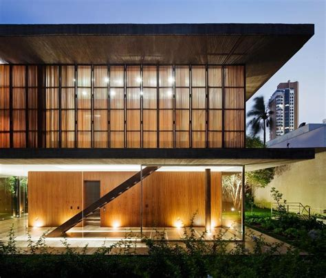 Long Glass House With Folding Wooden Facade