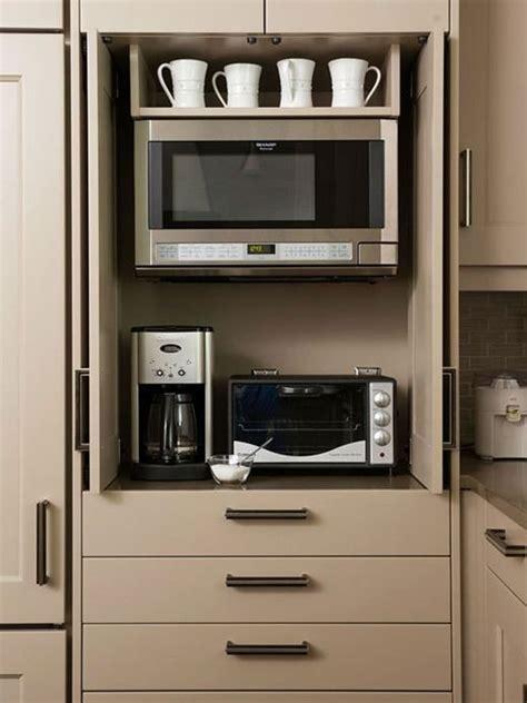 Love this hidden microwave/appliance center. Different