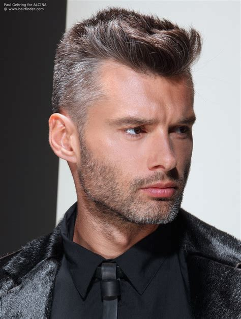 Practical short clipped men's hair with a salt and pepper