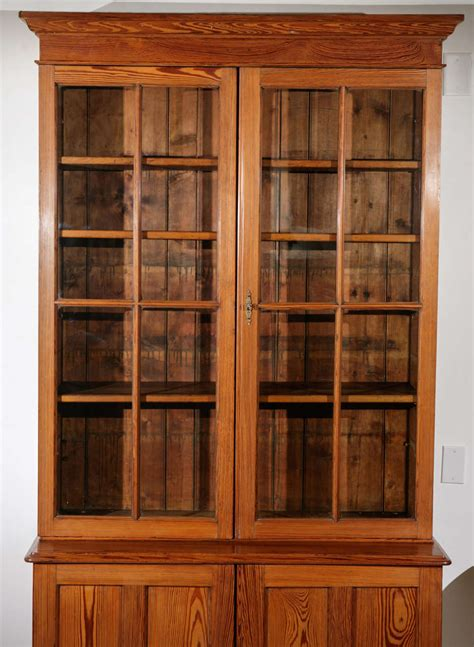 tall glass front cabinet tall glass front pine cabinet and bookcase at 1stdibs