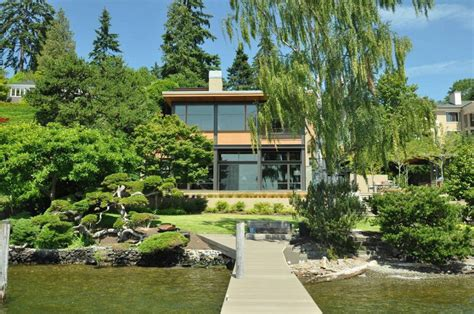 grand glass lake house  bold steel frame modern