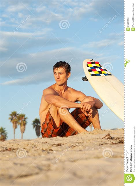 Sitting On The by Surfer Sitting On The With Surfboard Stock Photo