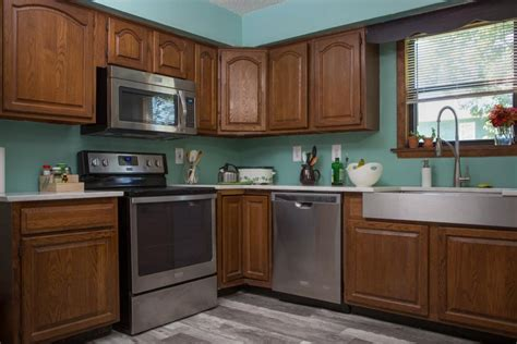 painting kitchen cabinets before after how to paint kitchen cabinets without sanding or priming
