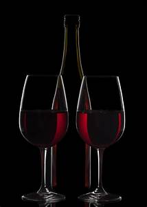Red Wine Bottle And Two Wine Glasses On Black Background ...