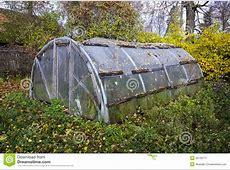 Old Primitive Plastic Greenhouse In Autumn Farm Garden