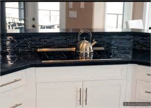 black glass backsplash kitchen backsplash goes black cabinets home design inside
