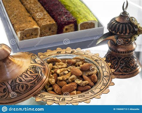 turkish copper cookware handmade  turks  candy dish  almonds  walnuts stock image